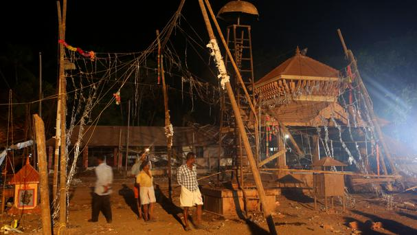 The massive fire broke out during a fireworks display at the Puttingal temple complex in Paravoor village, Kollam district, southern Kerala state (AP)