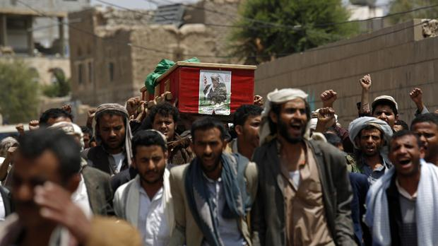 Shiite rebels, known as Houthis, carry the coffin of a fellow Houthi who was killed during fighting against Saudi-backed Yemeni forces in Marib (AP)
