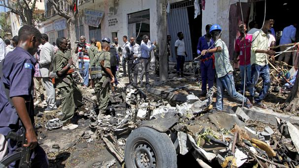 Security forces inspect the scene of a car bomb attack in the Somali capital Mogadishu (AP)