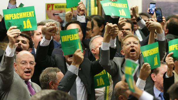 Opposition politicians celebrate after the result of the vote by a congressional committee in Brasilia (AP)