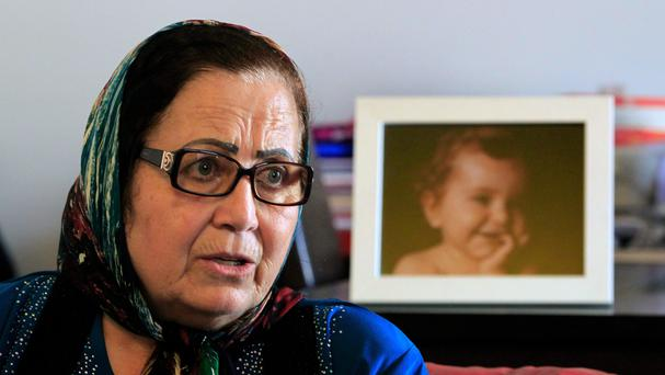Ibtissam Berri next to a picture of her granddaughter Lahela al-Amin, at her home in the southern suburbs of Beirut (AP)