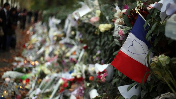 Floral tributes and candles opposite the Bataclan theatre in Paris