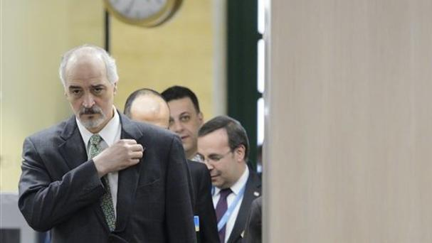 Syrian chief negotiator Bashar Ja'afari arrives at the meeting in Geneva (AP)