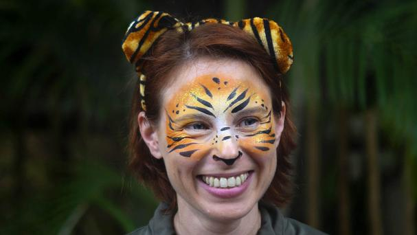 Stacey Konwiser pictured smiling in March last year during the dedication of the new tiger habitat at the Palm Beach Zoo (AP)