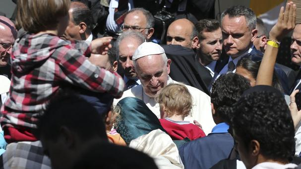 Pope Francis meets migrants at the Moria refugee camp on the Greek island of Lesbos (AP)