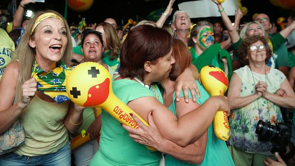 Anti-government demonstrators celebrate in Sao Paulo after the lower house of Congress voted to impeach Brazil's president Dilma Rousseff (AP)