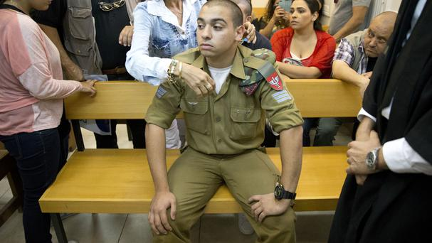 Israeli soldier Sergeant Elor Azaria sits inside a military court in Tel Aviv (AP)