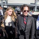 Actor Johnny Depp and wife Amber Heard leave the Southport Magistrates Court on Australia's Gold Coast, April 18, 2016. Hollywood actor Johnny Depp's wife, actress Amber Heard, appeared in a Queensland court Monday charged with illegally smuggling the coup