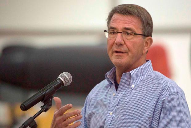 US Defense Secretary Ashton Carter talks to airmen during a tour of US Air Force assets at Al-Dhafra Air Base in the United Arab Emirates