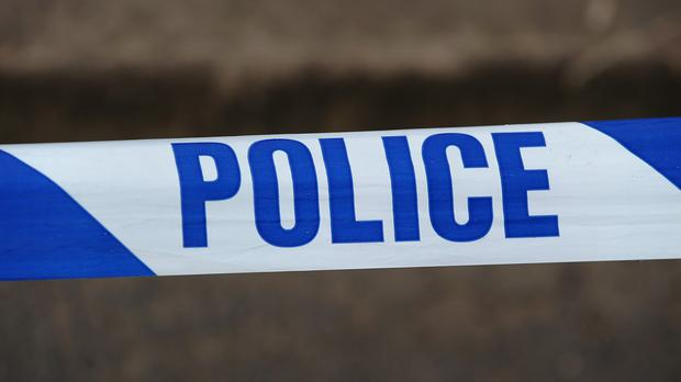 The 70 year old was knifed as he brandished a shop sign in a bid to defend himself
