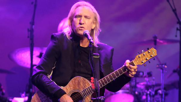 Joe Walsh said he thought the concert would be a non-political event for veterans' families (Invision/AP)