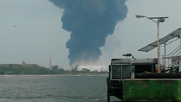 A large plume of smoke rises from Petroleos Mexicanos' petrochemical plant after an explosion in Coatzacoalcos (Inmel Enoc/AP)