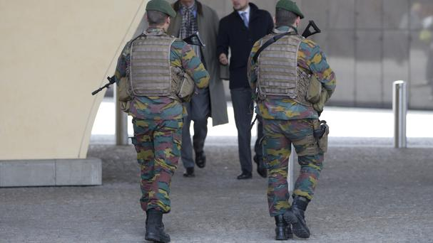 Belgian army soldiers patrol in the EU quarter of Brussels (AP)