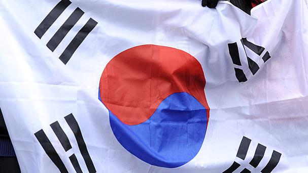 General view of a South Korea fans in the stands holding up a South Korea flag
