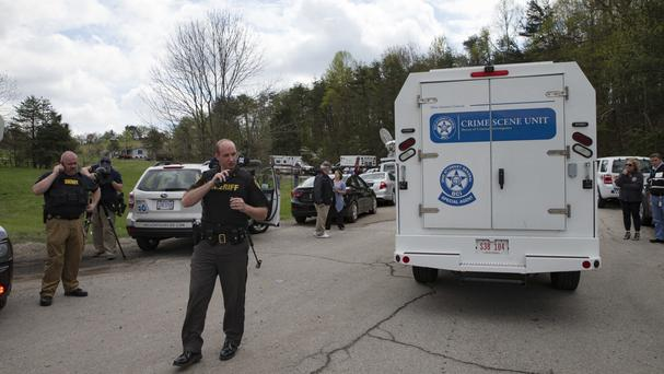 Crime scene investigators head for the site of the shootings (AP)