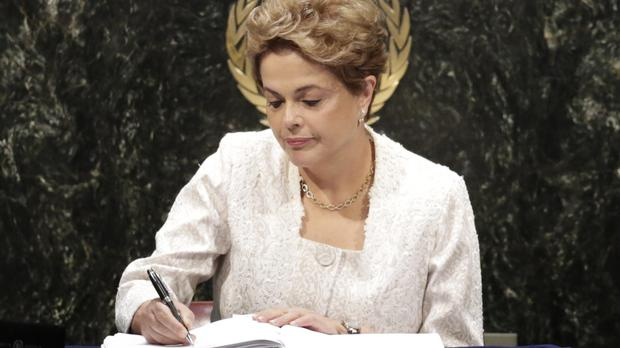 Dilma Rousseff signs the Paris Agreement on climate change at the UN's headquarters in New York (AP)