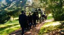 Sir Jack Leslie's funeral cortege goes through the grounds of Castle Leslie