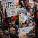 Thousands of demonstrators protest against the planned Transatlantic Trade and Investment Partnership in Hannover (AP)
