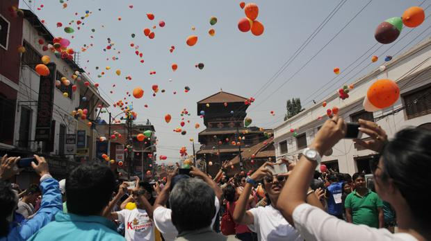 Nepalese people release balloons in memory of those who died in last year's earthquake (AP)