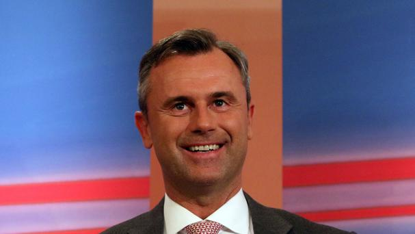 Norbert Hofer, candidate for president of Austria's Freedom Party, FPOE, smiles during the release of the first election results of the Austrian presidential elections (AP)