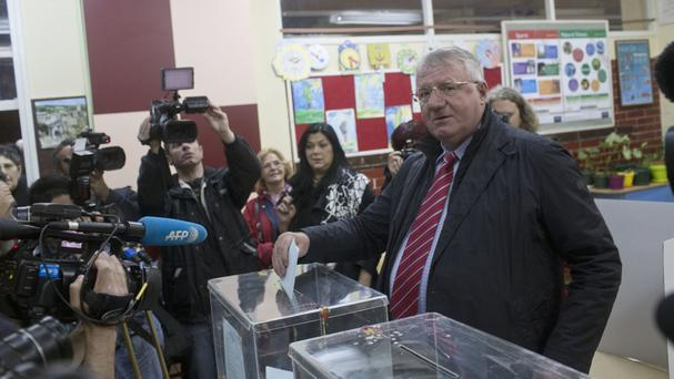 Vojislav Seselj casts his ballot at a polling station in Belgrade (AP)