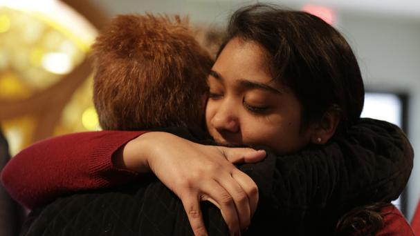 Nikita Deep embraces a family friend at a church service at Antigo United Methodist Church following the incident (The Marshfield News-Herald /AP)