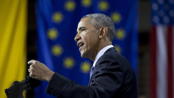 US president Barack Obama speaks in front of the European Union Flag at the Hanover Messe Trade Fair in Germany (AP)