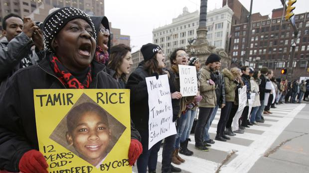 People protest against the police shooting of Tamir Rice (AP)