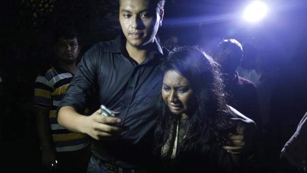 An unidentified co worker of USAID employee Xulhaz Mannan cries as she returns from the crime scene in Dhaka, Bangladesh (AP)