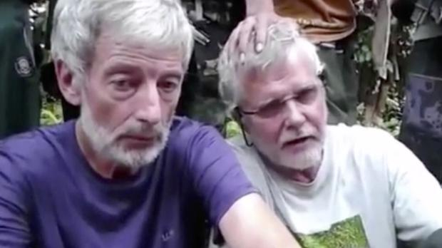 Canadian hostages John Ridsdel, right, and Robert Hall (Militant video via AP)