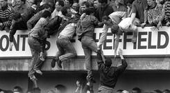 Liverpool fans desperately try to escape the crush at Hillsborough on April 15, 1989. Photo: PA