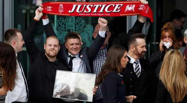 Relatives of the Hillsborough victims celebrate the inquests' verdict in Warrington yesterday