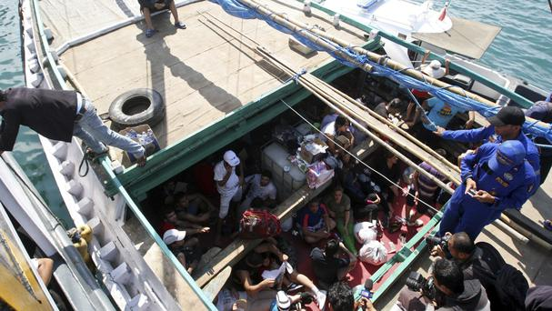 Iranian asylum seekers who were caught in Indonesian waters while sailing to Australia on a boat in Bali, Indonesia. (AP)