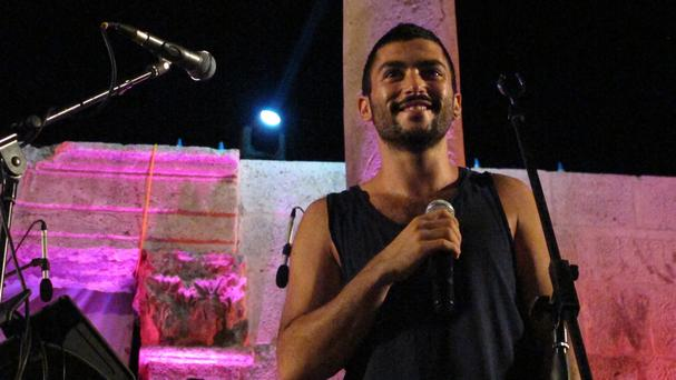 Hamed Sinno, lead singer and songwriter of Mashrou' Leila, performs with the band in the ancient Roman amphitheatre in the Jordanian capital Amman (AP)
