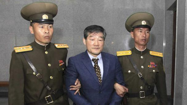 Kim Dong Chul, a US citizen detained in North Korea, is escorted to his trial in Pyongyang (AP)
