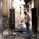 An employee of Doctors Without Borders walks inside the charred remains of a hospital after it was hit by a US air strike in Kunduz, Afghanistan (AP)