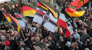 Right-wing demonstrators march in Cologne, Germany, in January in the aftermath of a string of sexual assaults and robberies on New Year's Eve blamed on immigrants. Only 30pc of Germans identify as global citizens. Photo: AP