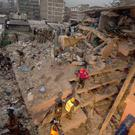 Rescuers work at the site of a building collapse in Nairobi, Kenya (AP)