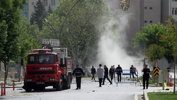 Security officers and firefighters moments after an explosion outside the police headquarters in Gaziantep, Turkey (Depo Photos/AP)