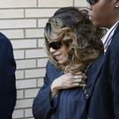 Tyka Nelson, centre, the sister of Prince, leaves the Carver County Courthouse (AP)
