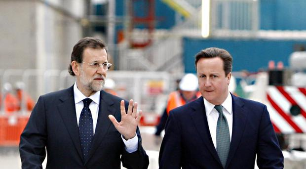 Mariano Rajoy (left) has been in charge on a caretaker basis