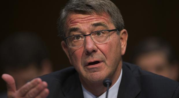 "Ash Carter said Moscow is ""going backward in time"" (AP)"