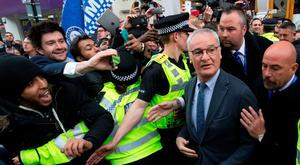 Claudio Ranieri is mobbed by fans as he leaves an Italian restaurant after having lunch with team-mates in the centre of Leicester. Photo: Getty