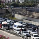 Israelis stand still next to their cars as a siren sounds in memory of victims of the Holocaust, in Tel Aviv (AP)