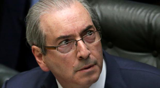 A justice on Brazil's supreme court has suspended Eduardo Cunha, which temporarily removes him (AP)