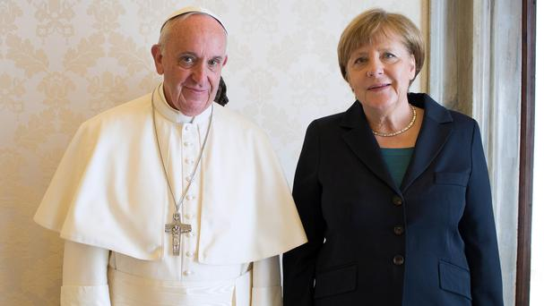 German Chancellor Angela Merkel and Pope Francis pose during a private audience at the Vatican (AP)