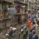 Residents are evicted from their apartment blocks close to the site of last week's building collapse in the Huruma neighbourhood of Nairobi, Kenya (AP)