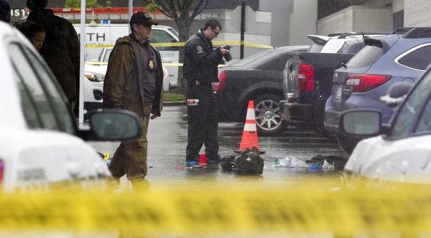 Two people have died in separate shootings at shopping centres