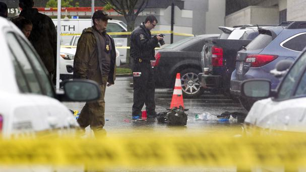 Police examine the scene at the Westfield Montgomery Mall in Bethesda (AP)