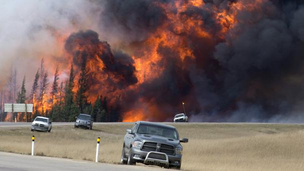 A wildfire burns south of Fort McMurray (Jonathan Hayward /The Canadian Press via AP)